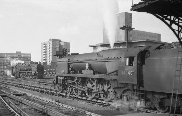 The summer of '66 and two steam engines at Waterloo station. For the record they are Merchant Navy no. 35027 'Port Line' and West Country no. 34040 Crewcerne